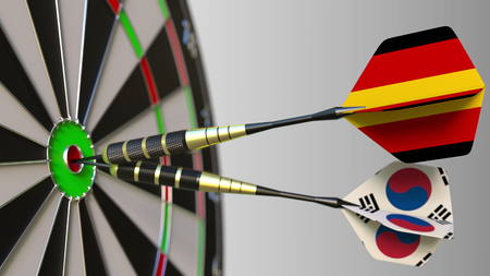 Flags of Germany and Korea on darts hitting bullseye of the target. International cooperation or competition conceptual 3D rendering