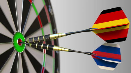 Flags of Germany and Russia on darts hitting bullseye of the target. International cooperation or competition conceptual 3D rendering