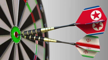 Flags of North Korea and Iran on darts hitting bullseye of the target. International cooperation or competition conceptual 3D rendering