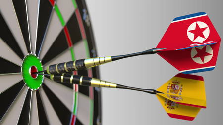 Flags of North Korea and Spain on darts hitting bullseye of the target. International cooperation or competition conceptual 3D rendering