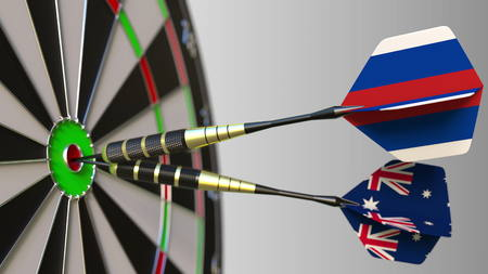 Flags of Russia and Australia on darts hitting bullseye of the target. International cooperation or competition conceptual 3D rendering Stock Photo