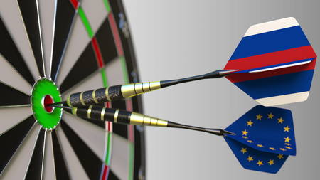 Flags of Russia and the European Union on darts hitting bullseye of the target. International cooperation or competition conceptual 3D rendering