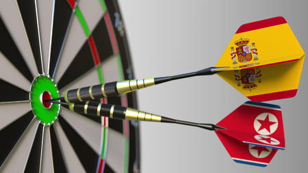 Flags of Spain and North Korea on darts hitting bullseye of the target. International cooperation or competition conceptual 3D rendering