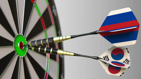 Flags of Russia and Korea on darts hitting bullseye of the target. International cooperation or competition conceptual 3D rendering Stock Photo