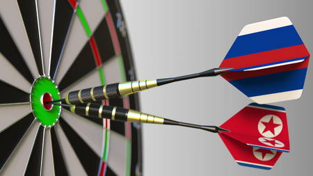 Flags of Russia and North Korea on darts hitting bullseye of the target. International cooperation or competition conceptual 3D rendering