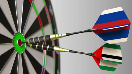 Flags of Russia and the UAE on darts hitting bullseye of the target. International cooperation or competition conceptual 3D rendering