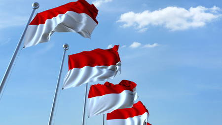 Waving flags of Indonesia against the sky. 3D rendering Archivio Fotografico