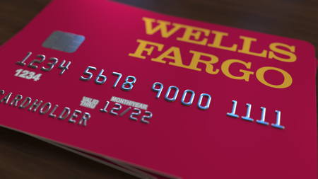 Plastic bank card with logo of Wells Fargo. Editorial conceptual 3D rendering