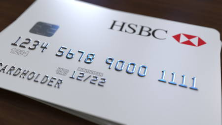 Plastic bank card with logo of HSBC. Editorial conceptual 3D rendering