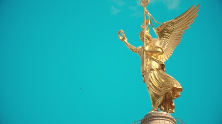 Long shot of the golden statue atop famous Berlin Victory Column, Germany