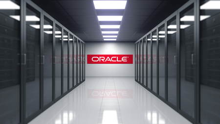 Oracle Corporation logo on the wall of the server room. Editorial 3D rendering