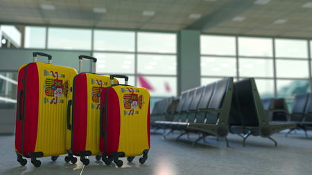 Travel suitcases featuring flag of Spain. Spanish tourism conceptual 3D rendering Stock Photo