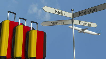 Travel baggage featuring flag of Germany, airplane and city sign post. German tourism conceptual 3D rendering