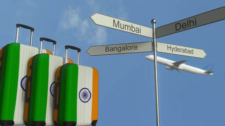 Travel baggage featuring flag of India, airplane and city sign post. Indian tourism conceptual 3D rendering Stock Photo