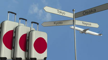 Travel baggage featuring flag of Japan, airplane and city sign post. Japanese tourism conceptual 3D rendering Stock Photo