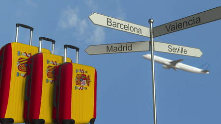 Travel baggage featuring flag of Spain, airplane and city sign post. Spanish tourism conceptual 3D rendering Stock Photo