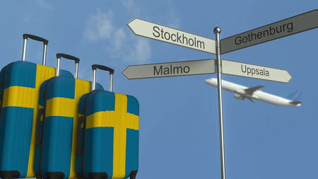 Travel baggage featuring flag of Sweden, airplane and city sign post. Swedish tourism conceptual 3D rendering Stock Photo