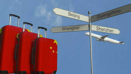 Travel baggage featuring flag of China, airplane and city sign post. Chinese tourism conceptual 3D rendering Stock Photo