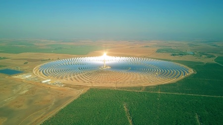 Aerial view of a modern circular solar power plant