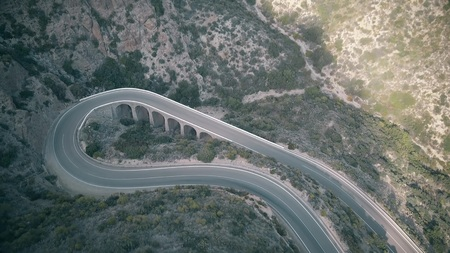 Aerial view of sharp hairpin turn in mountains