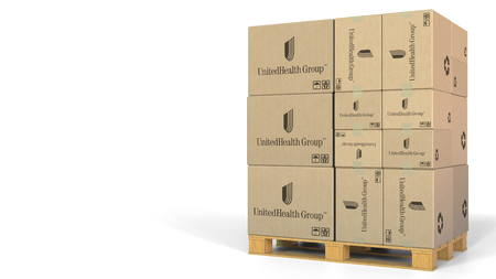 Many cartons with UnitedHealth Group logo. Editorial 3D rendering