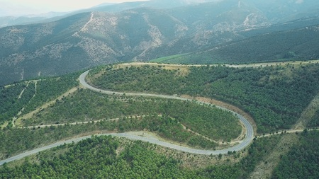 Aerial shot of a windy car road in Sierra Nevada National Park mountains, Spain