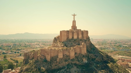 Aerial view of statue of Christ and Castillo de Monteagudo, Spain