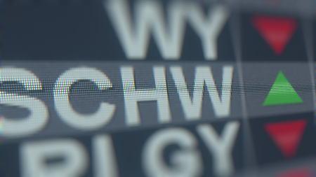 CHARLES SCHWAB SCHW stock ticker on the screen. Editorial 3D rendering Editorial