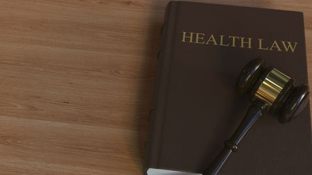 HEALTH LAW book and judge gavel. 3D rendering