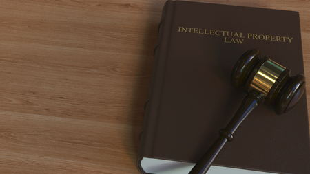 INTELLECTUAL PROPERTY LAW  book and judge gavel. 3D rendering 版權商用圖片
