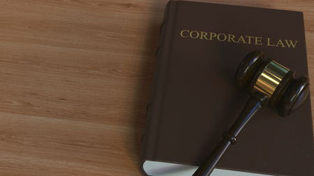 CORPORATE LAW book and judge gavel. 3D rendering