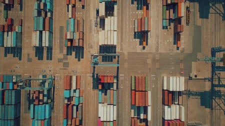 VALENCIA, SPAIN - OCTOBER 2, 2018. Aerial top-down view of big seaport container yard