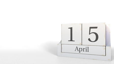 Cube calendar shows April 15 date. 3D rendering