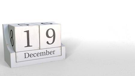 Wood cube calendar shows December 19 date, 3D rendering
