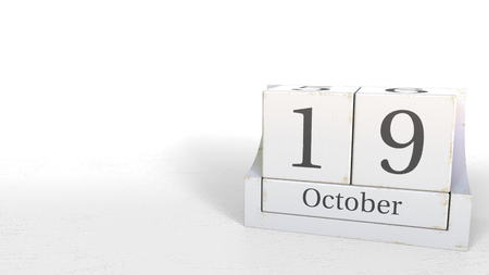 Cube calendar shows October 19 date. 3D rendering 写真素材