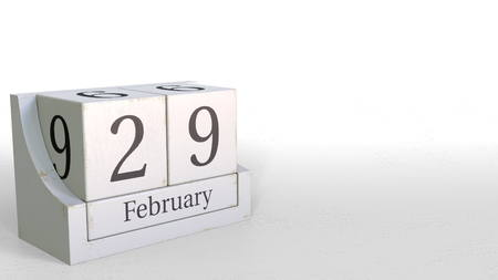Wood cube calendar shows February 29 date, 3D rendering