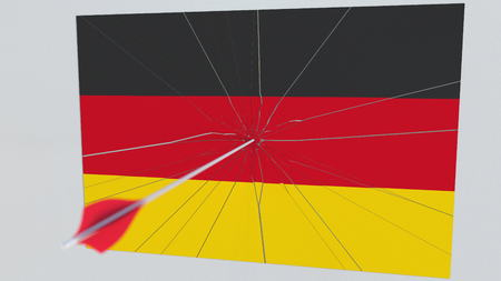 Flag of GERMANY plate being hit by archery arrow. Conceptual 3D rendering Stock Photo