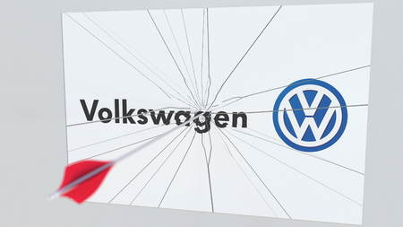 VOLKSWAGEN company logo being cracked by archery arrow. Corporate problems conceptual editorial 3D rendering Editorial