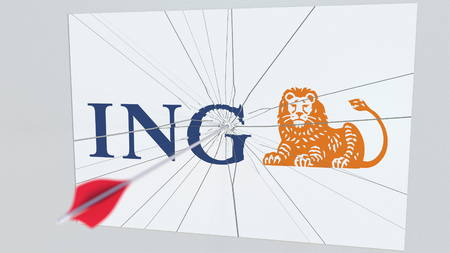 Archery arrow breaks glass plate with ING company logo. Business issue conceptual editorial 3D rendering Editorial