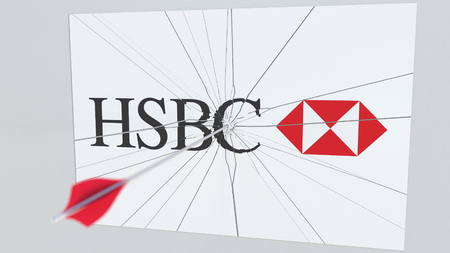 HSBC company logo being cracked by archery arrow. Corporate problems conceptual editorial 3D rendering Editoriali