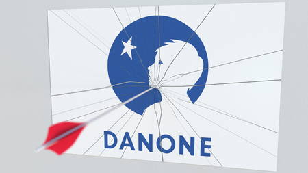 Archery arrow breaks glass plate with DANONE company logo. Business issue conceptual editorial 3D rendering