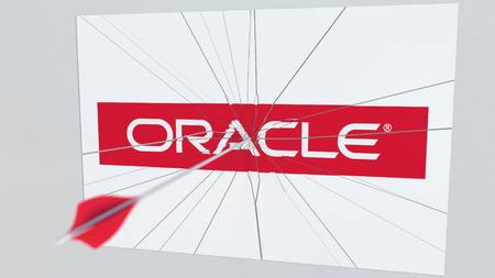 ORACLE company logo being hit by archery arrow. Business crisis conceptual editorial 3D rendering Banco de Imagens - 120107583