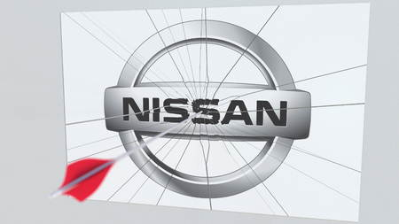 NISSAN company logo being hit by archery arrow. Business crisis conceptual editorial 3D rendering