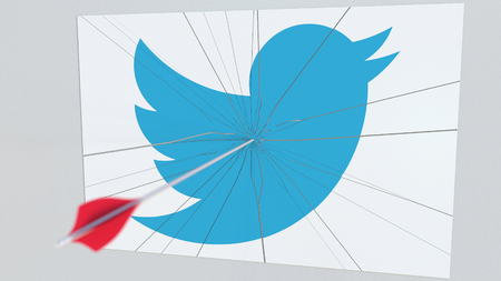 TWITTER company logo being hit by archery arrow. Business crisis conceptual editorial 3D rendering