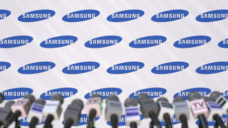 Media event of SAMSUNG, press wall with logo and microphones, editorial 3D rendering