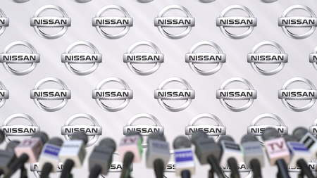 Media event of NISSAN, press wall with logo and microphones, editorial 3D rendering