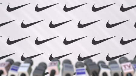 NIKE company press conference, press wall with logo and mics, conceptual editorial 3D rendering