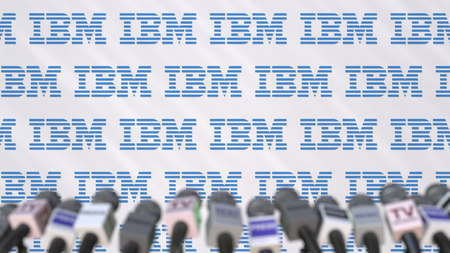 Media event of IBM, press wall with logo and microphones, editorial 3D rendering Editorial