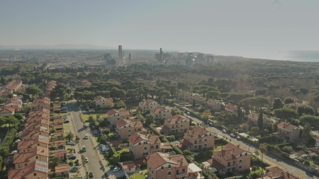 Aerial view of a residential area against air polluting plant Stock Photo