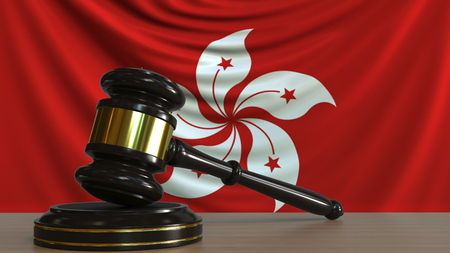 Judges gavel and block against the flag of Hong kong. Court conceptual 3D rendering